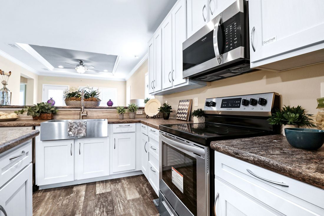 The THE CRENSHAW Kitchen. This Manufactured Mobile Home features 3 bedrooms and 2 baths.