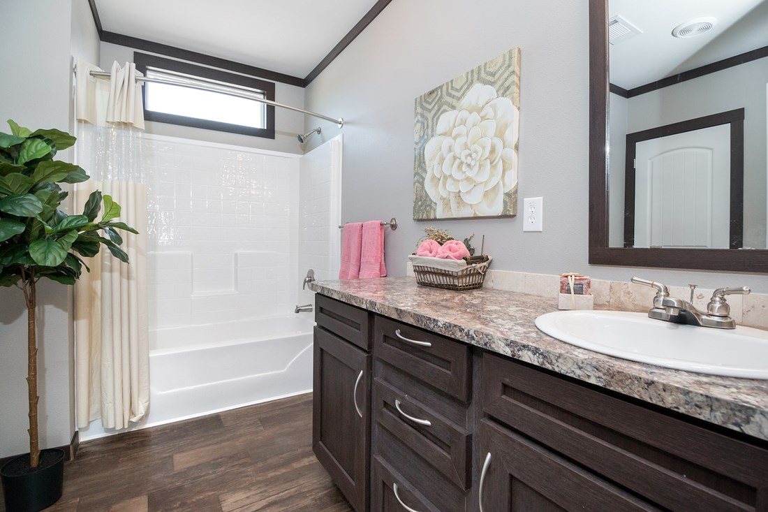 The THE GEORGETOWN Guest Bathroom. This Manufactured Mobile Home features 4 bedrooms and 2 baths.