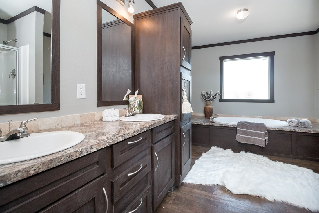 The THE GEORGETOWN Master Bathroom. This Manufactured Mobile Home features 4 bedrooms and 2 baths.