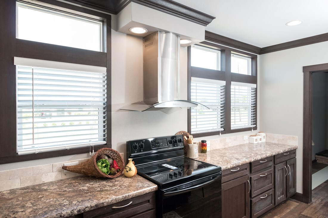 The THE GEORGETOWN Kitchen. This Manufactured Mobile Home features 4 bedrooms and 2 baths.